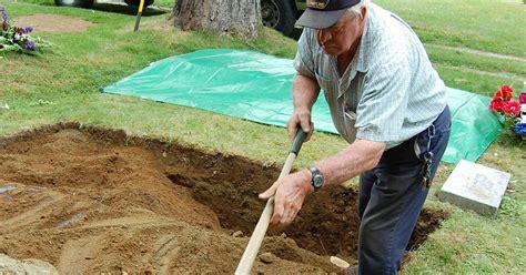 school gravedigger plies  trade cbs news