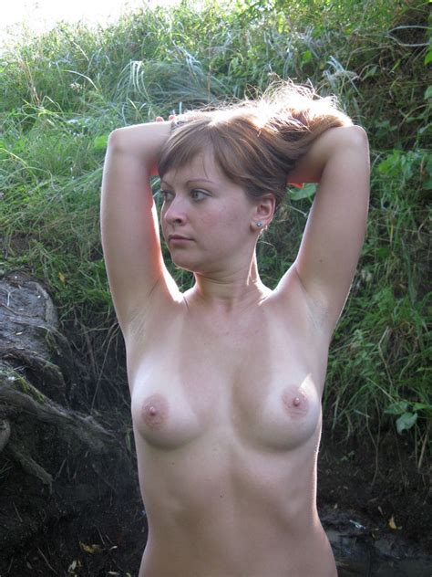 Lovely russian amateur girl posing naked outdoors ...