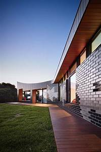The Glazed Brick Facade at This Beach House is Inspired By ...