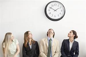 Interviewees look up at a clock on the wall