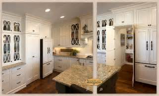 White L Shaped Kitchen With Island Cabinets A Showplace Walk In Pantry Cabinet Adds Convenience To This Graceful Kitchen Design