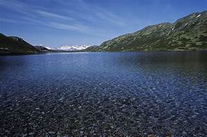 Scenic View Of A Calm Mountain Lake Photograph by Kenneth