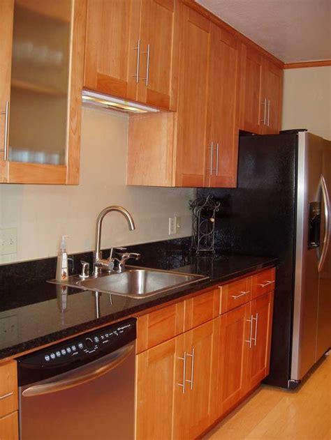 oak and black kitchen cabinets honey oak kitchen cabinets with black countertops honey