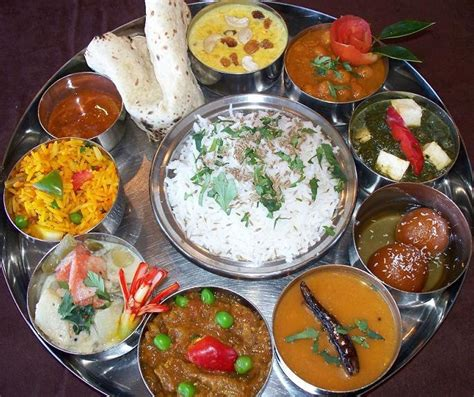 thali a large plate with various indian food with