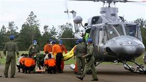 Six bodies recovered from near crashed AirAsia jet fuselage