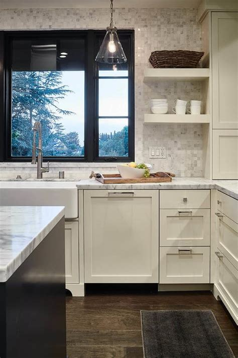 ivory shaker kitchen cabinets  white marble grid tile