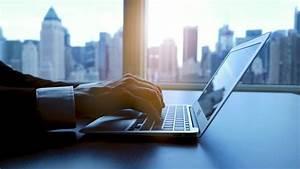 Laptop Desk View In Modern Business Office  City Skyline