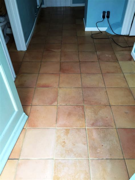 cleaning wax and from terracotta floor tiles in