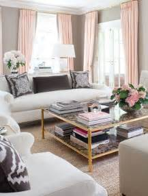 fashion home interiors living room with gray walls and pink decor accents so into decorating