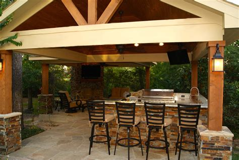 freestanding patio cover  kitchen fireplace   woodlands texas custom patios