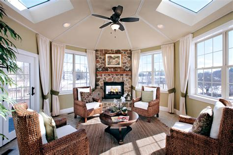 sunrooms with fireplaces this sunroom features a stone fireplace with a wood mantel tile floors and wicker furniture