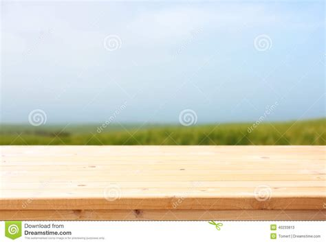 wooden table  meadow background ready food product