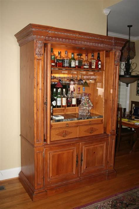 armoire cabinet into a bar repurposed entertainment center as a bar www chefbrandy