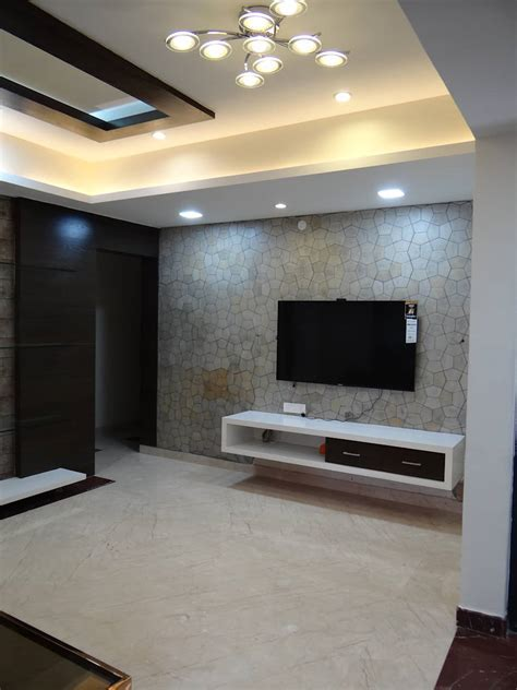 Tv wall cabinet with stone cladding background: modern
