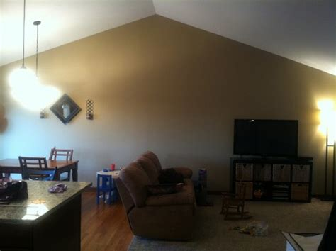 how to decorate walls with vaulted ceilings what to do with large vaulted ceiling wall