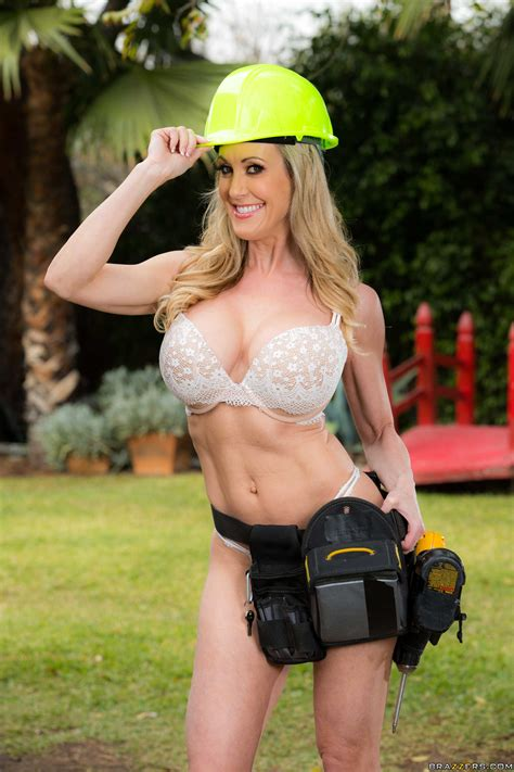 blonde woman is fucking two construction workers photos