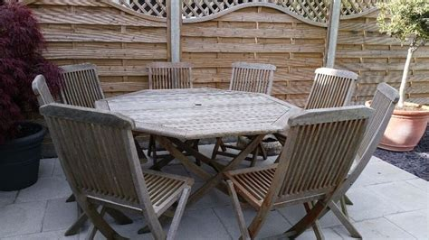 wooden octagonal garden table   chairs provisionally