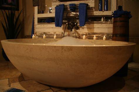 lavish freestanding stone tub   west bath rustic