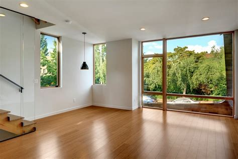 Bamboo flooring, white walls and floor to ceiling window