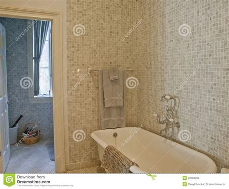 Old Fashioned Tub In Mosaic Tile Bathroom Stock Image