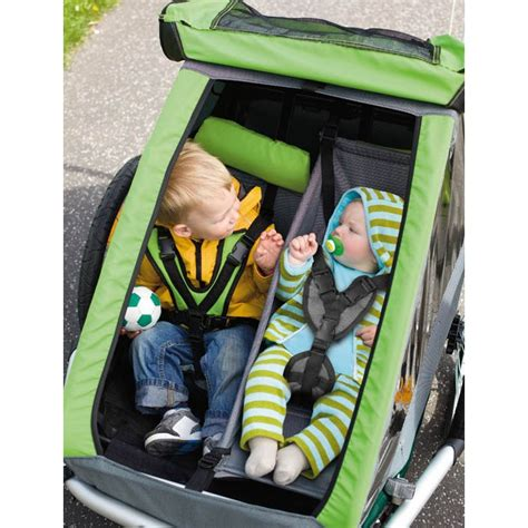 croozer kid 2 croozer kid 1 and 2 plus the suspense is for the new arrival changing bikes