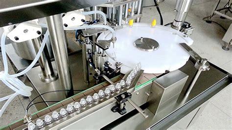 ampoule bottles vials caps plugging capping machine rotary fill emplissage de liquide ligne