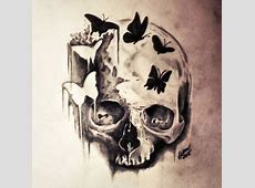 Scary skull with small white and black butterflies tattoo