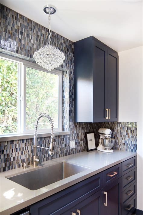 Blue and White Mid Century Kitchen with Glass Tile