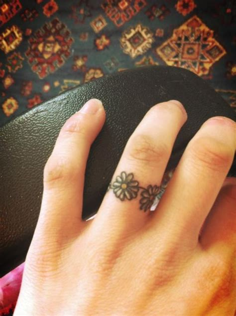 small daisy tattoos  ring finger tattooshuntcom