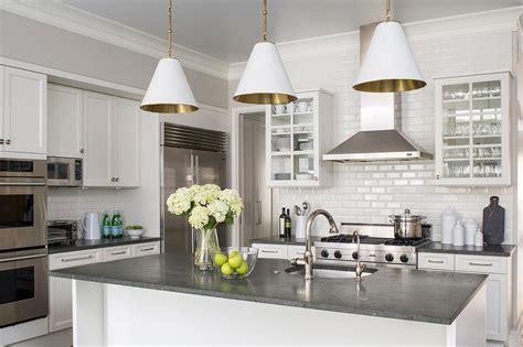 white kitchen cabinets  concrete countertops