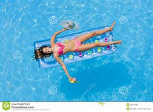 A Girl Is Relaxing In A Swimming Pool Stock Photo - Image ...