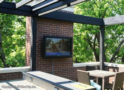great  outdoor patio wit wall mounted flat panel tv