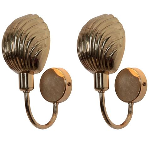 pair of brass shell wall ls or sconces at 1stdibs