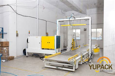 china automatic pallet skid strapping strap machine  conveyor system china strapping