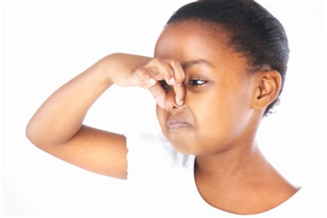 young girl holding nose stock photo getty images