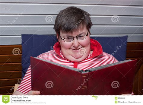 mentally disabled woman reads  book royalty  stock