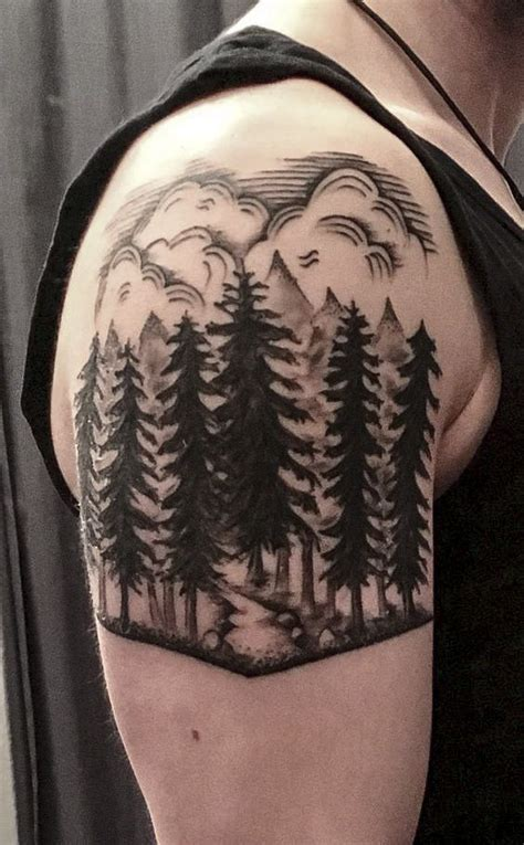 forest scene tattoo   upper arm nature trees