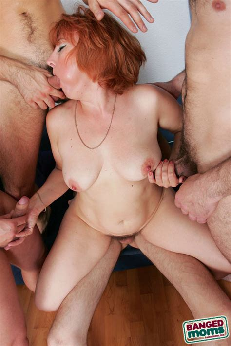 This Sinful Redhead Mom Needs 4 Younger Studs To Satisfy
