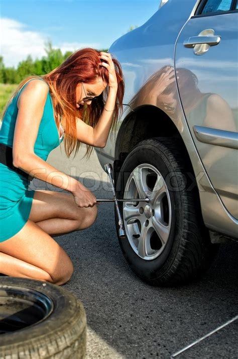 pretty girl    change  tire   road stock