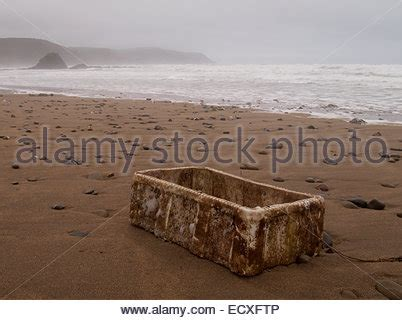 Old Boat Washed Up by Old Boat Washed Up On The Beach Stock Photo Royalty Free