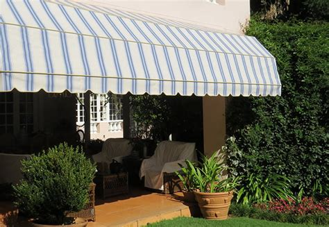 retractable awnings fold arm awnings  canvas corporation