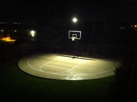 outdoor basketball court lighting during the night time the lights turn on for homeowners