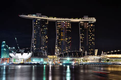 Boat At Marina Bay by Marina Bay Sands The Building With A Ship On Top