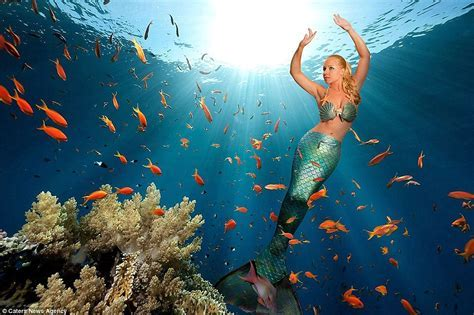 Mermaid Melissa swimming with Giant Manta Rays in the