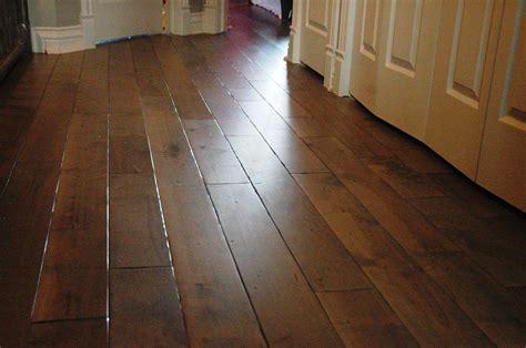 Kitchen Herb Garden Ideas - wide plank distressed oak hardwood flooring in kitchen with white cabinet ideas