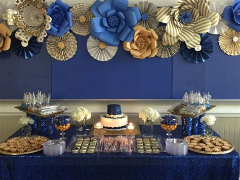 Royal blue and gold dessert table with paper flowers and
