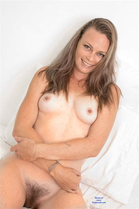 Hairy Pussy From A Smiling Naked Brunette February Voyeur Web Hall Of Fame