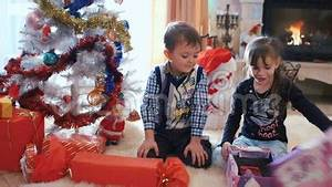 Children Opening Their Christmas Gifts Stock Footage