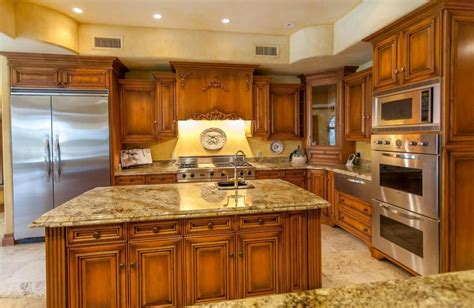traditional kitchen with travertine tile floors built in