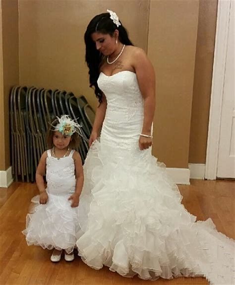 Wedding dresses for bride and baby girl.